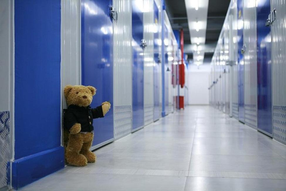 Teddy bear in storage hallway